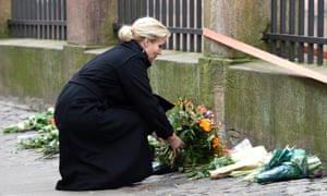 Helle Thorning-Schmidt, Denmark's prime minister places flowers in front of the synagogue in Krystalgade in Copenhagen