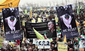 During a rally to mark the 36th anniversary of the Iranian revolution, demonstrators in Tehran hold a portrait of Iranian commander Major Gen Qassem Soleimani (center), who has been advising Iraqi military leaders fighting Islamic jihadists.