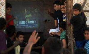 Indian fans watch in Mumbai.