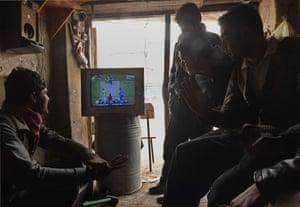 Afghan shopkeepers watch in Kabul.