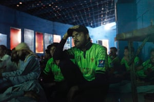 Pakistani fans watch at an auditorium in Karachi.