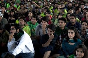 Pakistani cricket fans watch on a big screen in the neighborhood of Karachi.