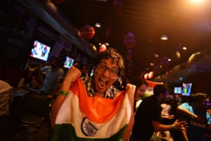 Indian cricket fan reacts as he and others watch in New Delhi.