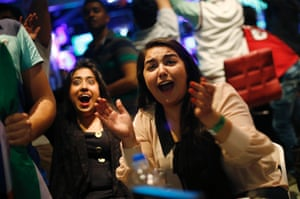 Indian fans react as they watch their team in New Delhi.