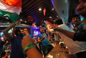 Indian fans dance as they cheer for their team  in New Delhi.