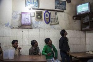 Indians at a teashop in New Delhi.