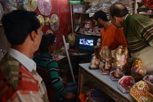 Indian shopkeepers watch in Amritsar.