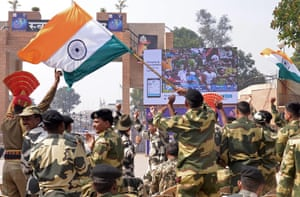Indian Border Security Force (BSF) personnel celebrate as they watch live at the India-Pakistan Wagah Border Post.