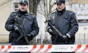 Danish police secure the scene near where the suspect was shot dead early on Sunday.