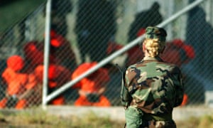 A soldier from the US Army watches over detainees in Guantánamo Bay