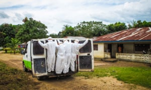 Health workers transport a person suspected to have died of Ebola in Port Loko, on the outskirts of Freetown.