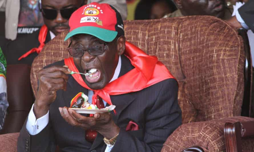 Robert Mugabe eats a piece of cake during a celebration to mark his 88th birthday