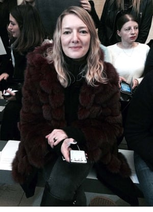 Rebecca Lowthorpe wears a thin, dark, ripped polo neck under faux fur