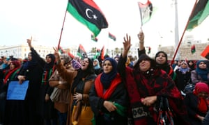 "Libyan protesters at a rally in Tripoli's Martyr's Square in support of ""Fajr Libya"" (Libya Dawn). Delegates from Libya's rival parliaments recently held indirect talks aimed at ending months of of violence."