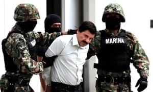 Soldiers escort Joaquin Guzman, known as El Chapo, following his arrest.