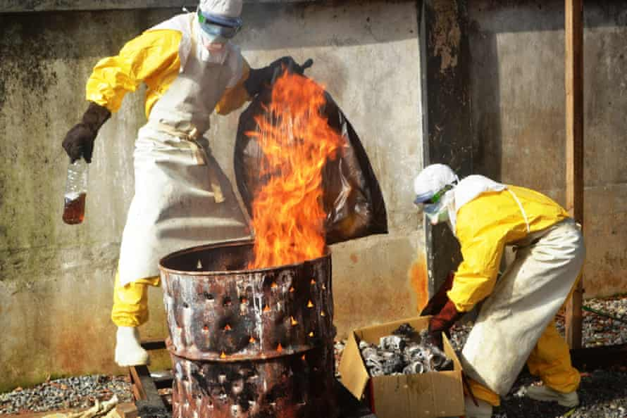 Health workers burning used protection gear at the Médecins Sans Frontières Ebola centre in Conakry, Guinea.