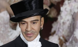 John Galliano acknowledges the audience after the Christian Dior spring-summer collection show in Paris in 2010.
