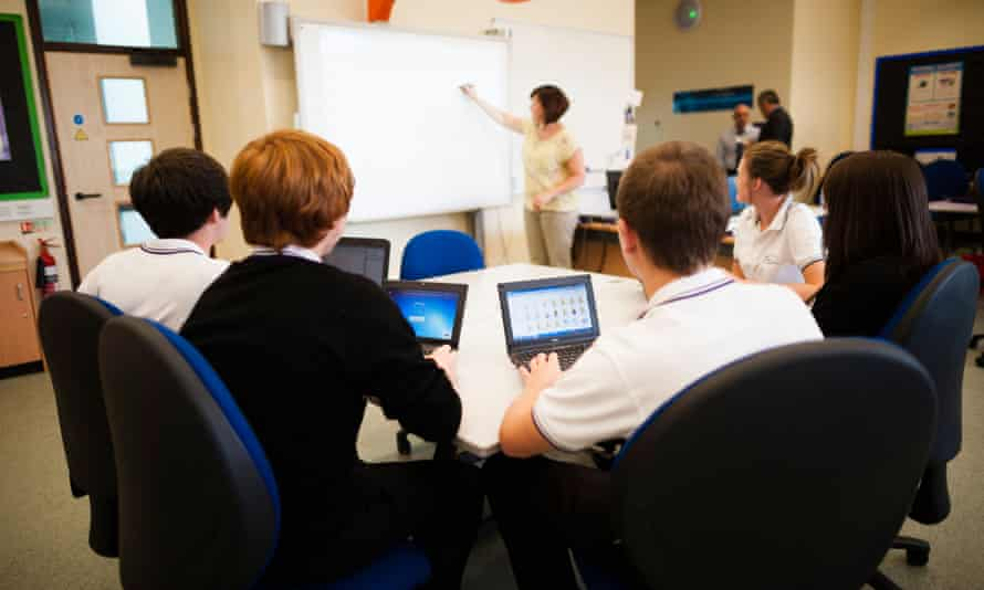 A-level pupils use tablet computers in class at a secondary school in Wales.