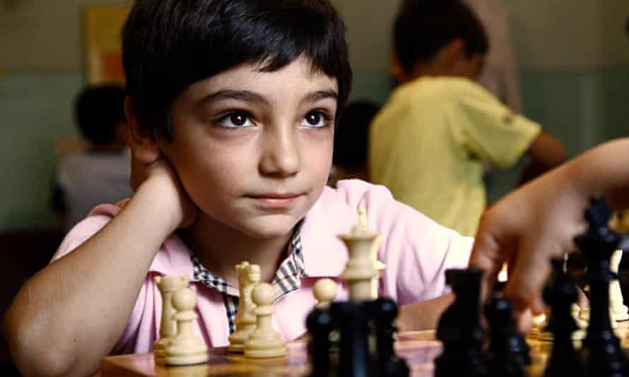 Eight-year-old David Ayrapetyan plays a game of chess at school in Yerevan, Armenia.