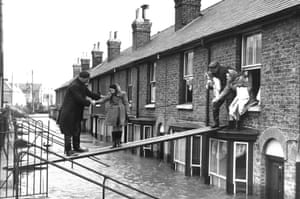 A family escape their flooded home in Whitstable, Kent, in February 1953.