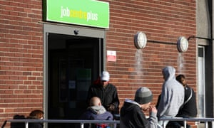 People waiting outside a Job Centre Plus in Nottingham