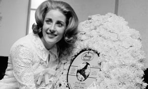 Lesley Gore celebrating her 18th birthday in 1964 with a copy of her hit record It's My Party bedecked in flowers. Photograph: Marty Lederhandler/AP