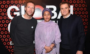 Coldplay frontman Chris Martin, left, UN Secretary-General's Special Adviser on Post-2015 Development Planning, Amina J Mohammed, center, and CEO of The Global Poverty Project Hugh Evans, pose together at the Global Citizen 2015 media luncheon at Locanda Verde
