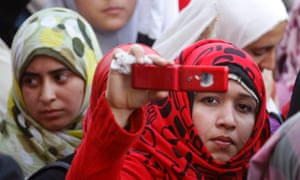 Girls in Cairo at a student protest in 2011