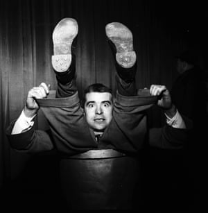 1955: Norberti, nephew of Grock, the celebrated Swiss clown, demonstrating his remarkable contortionist's skills.