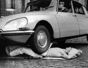 <strong>Fakir Mirah Soumak bears the weight of a Citroen DS, plus passengers, as it drives over his stomach in the Grande Place, Brussels</strong>