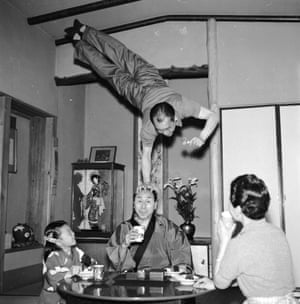 Japanese acrobat Gyokusho Terajima interrupts a family dinner to perform an impromptu somersault over his brother Chame's head.
