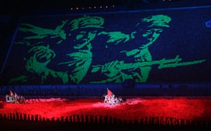 A picture of soldiers is created as a background during the mass gymnastic and artistic performance