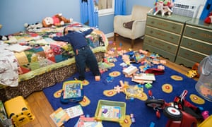 Young Boy In Messy Bedroom