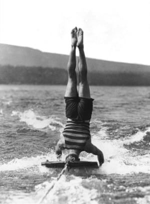 15th September 1925: One of the most difficult aquaplane stunts, water-surfing upside down, performed by Mr Brooks, at Lake Tahoe, California, where the sport is very popular.