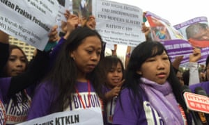 Erwiana Sulystyaningsih, right, is joined by supporters in Hong Kong demonstrating against abuse of women domestic workers.
