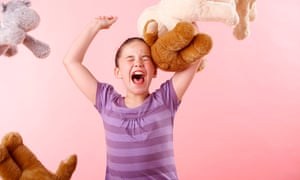Girl throwing teddy bears