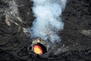 An open lava tube smokes and bubbles on Kilauea Volcano, Hawaii