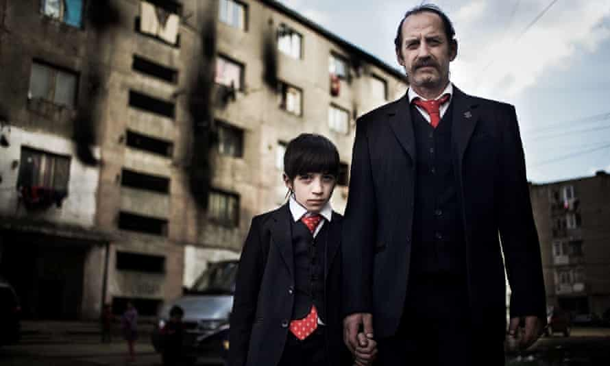 The Romanians Are Coming: Sandu and his son Antonio outside their Romanian home.