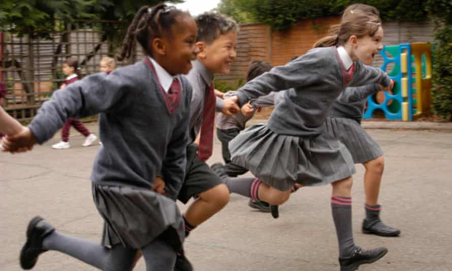 Pupils in a school playground. The letter says that schools should try to 'model a community of communities'.