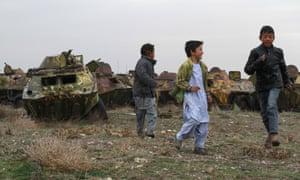 Afghan boys play Soviet-era tank