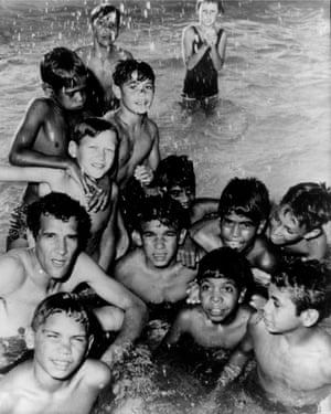Charles Perkins with a group of Aboriginal children swimming in the spa baths of Moree