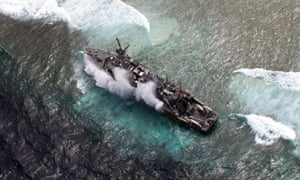 The US Navy minesweeper, the USS Guardian, lies trapped on the Tubbataha reef after it ran aground on the western Philippine island of Palawan.  The US has agreed to pay the Philippines nearly $2m in damages for the incident.