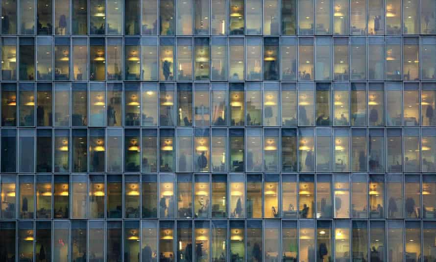 People at work in an office block
