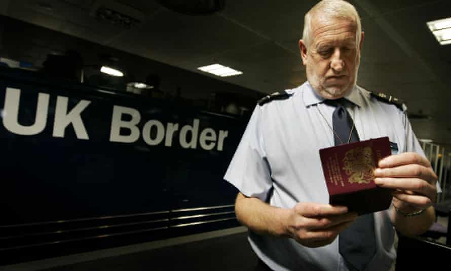 Passports are checked at Gatwick airport in West Sussex.