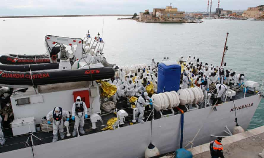 Migrants arrive at the Porto Empedocle, Sicily,