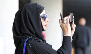 A spectator at Meydan racecourse in Dubai.