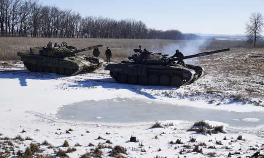 The spoils of war: pro-Russia rebels recover a tank (left) abandoned by retreating Ukrainian troops.