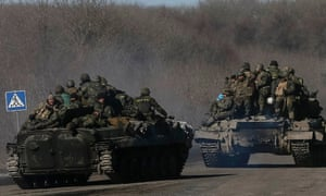 The retreat continues: Ukrainian servicemen approach Artemivsk after withdrawing from the key town of Debaltseve.