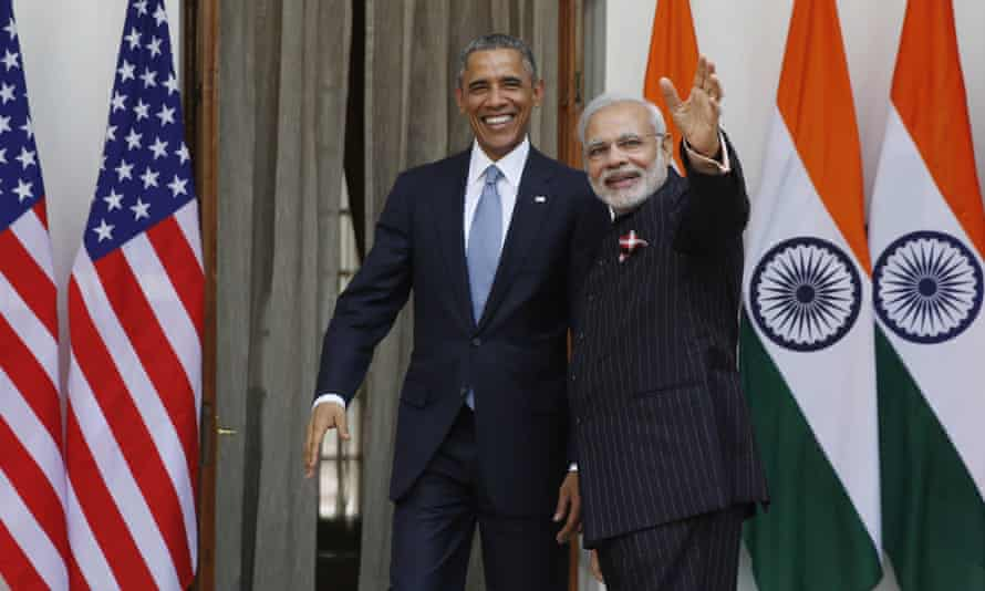 Barack Obama welcomed by Narendra Modi in his monogram pinstripe suit.