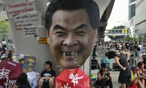 Leung Chun-ying, with added fangs, looms over a Hong Kong pro-democracy protest site